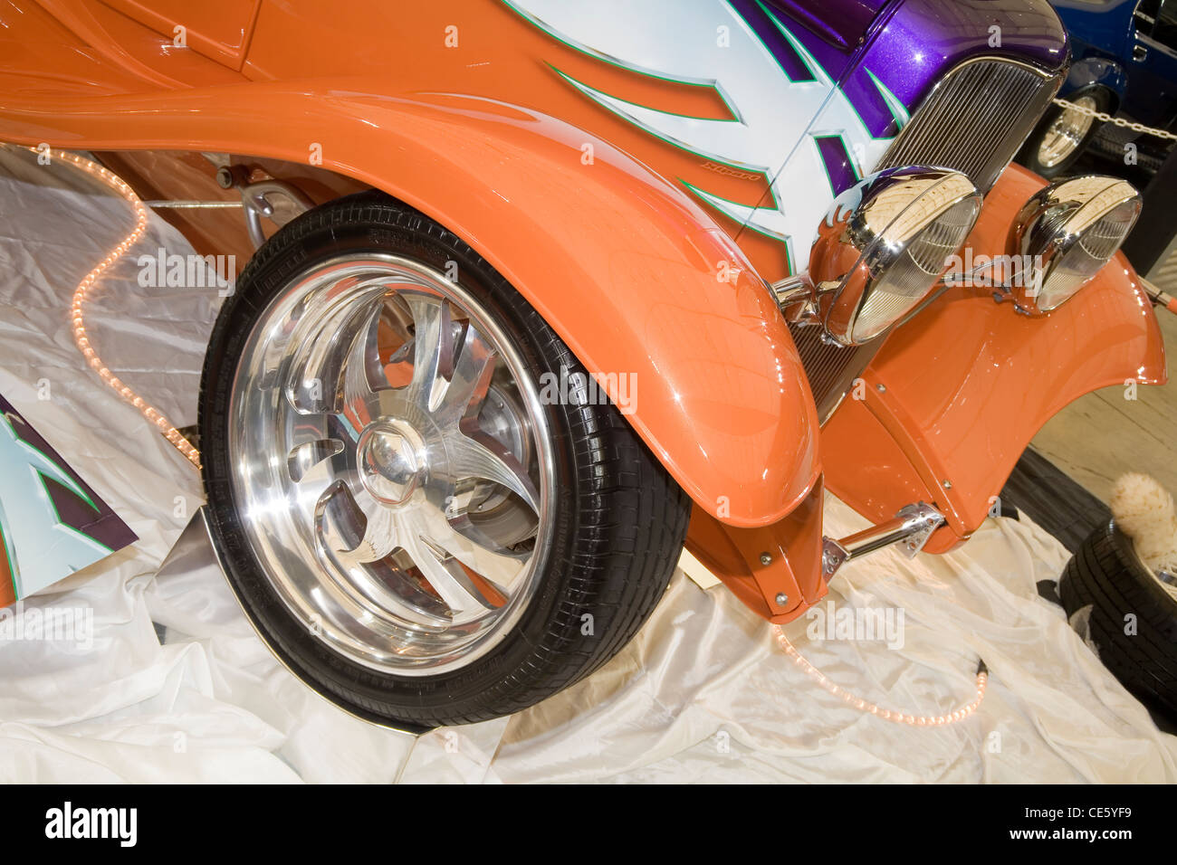 Shiny polished alloy billet hotrod wheel on a show vehicle at a hot rod show and display - Stock Image