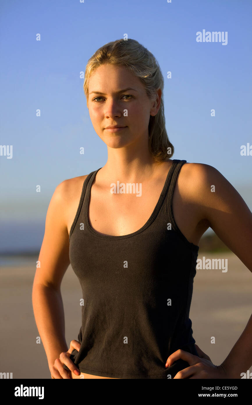 Young athletic woman with hands on hips - Stock Image