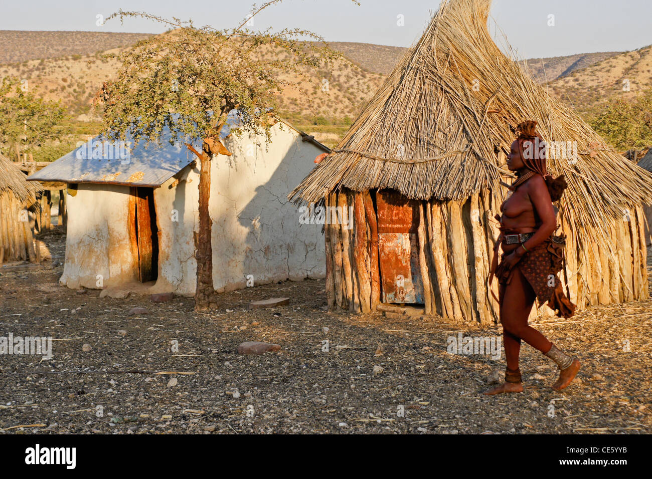Himba woman in village near Opuwo, Namibia - Stock Image