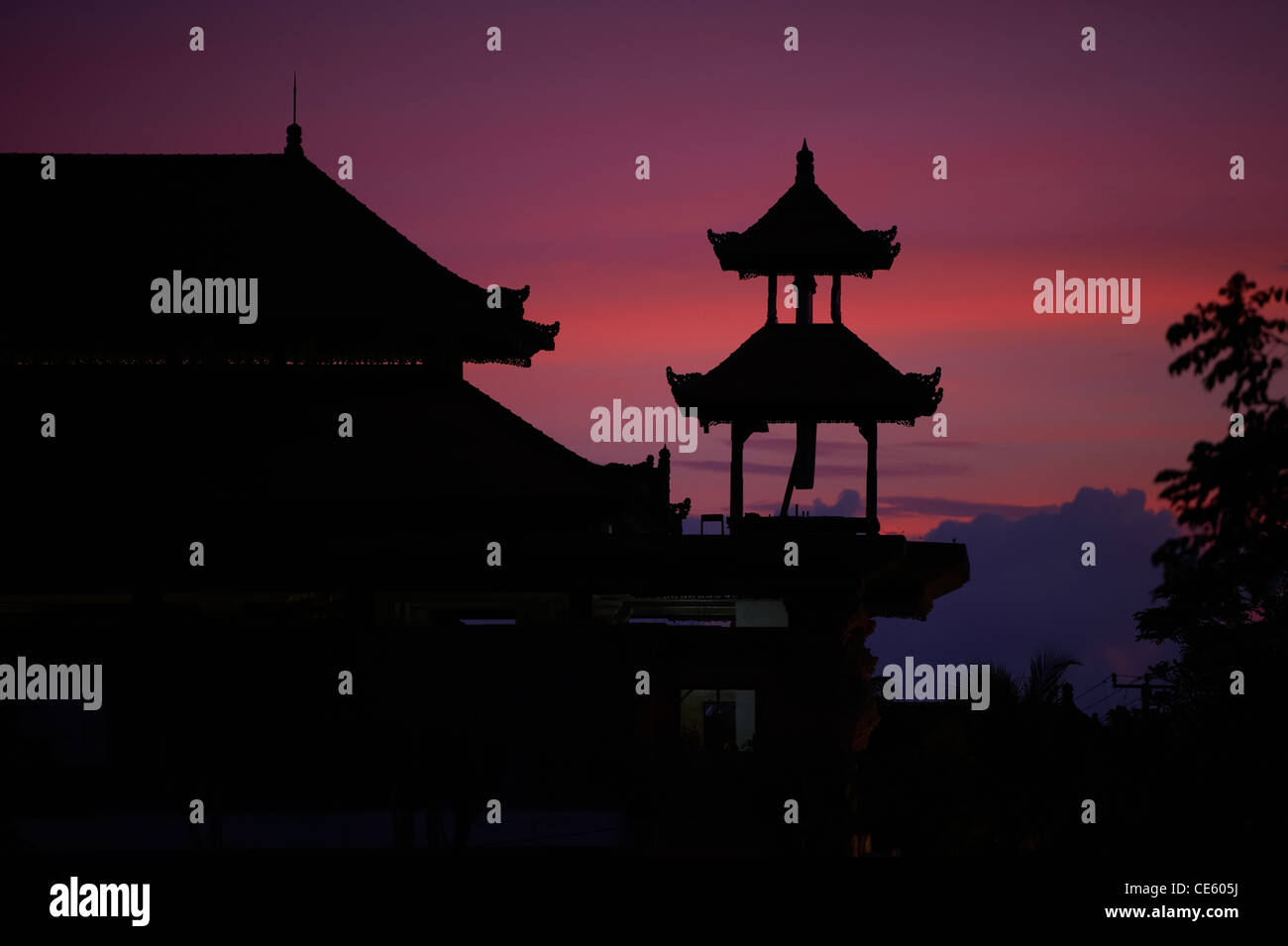 Hindu temple silhouetted in dusk sky, Ubud Bali Indonesia - Stock Image
