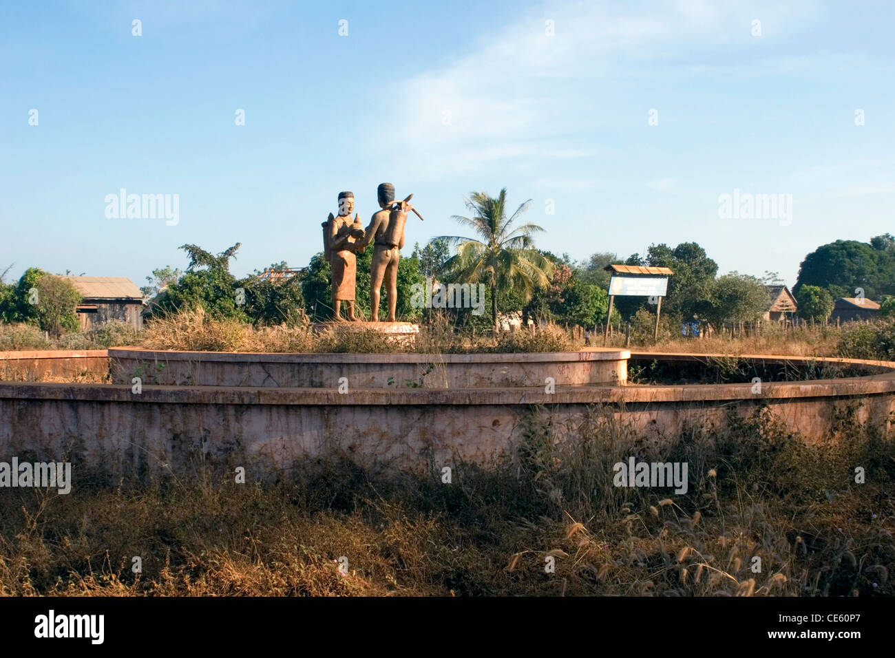A monument to rural farmers marks a crossroads near Ban Lung in Ratanakiri Province, Cambodia. - Stock Image