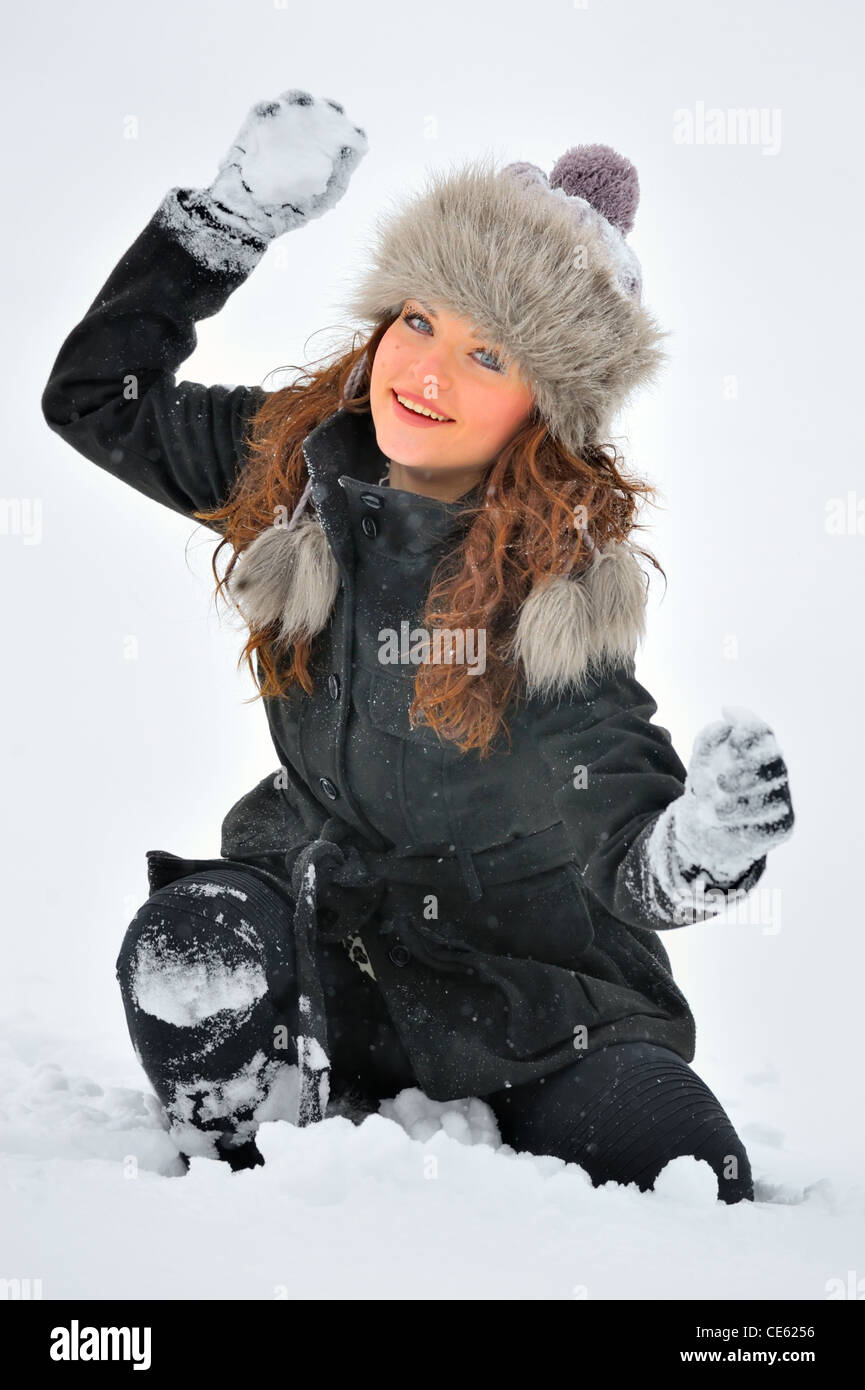 Young Beautiful Woman play in winter time - Stock Image