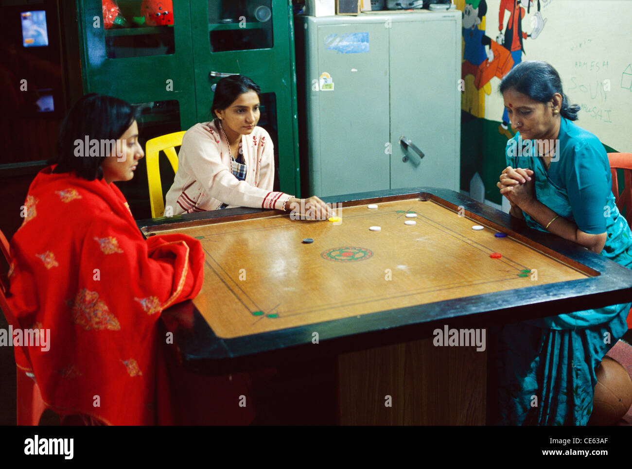 Indian Family Playing Carrom Game Stock Photos & Indian