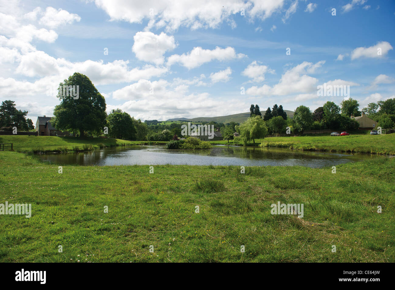 The duck pond in Caldbeck Cumbrian Village Lake District UK English Countryside - Stock Image