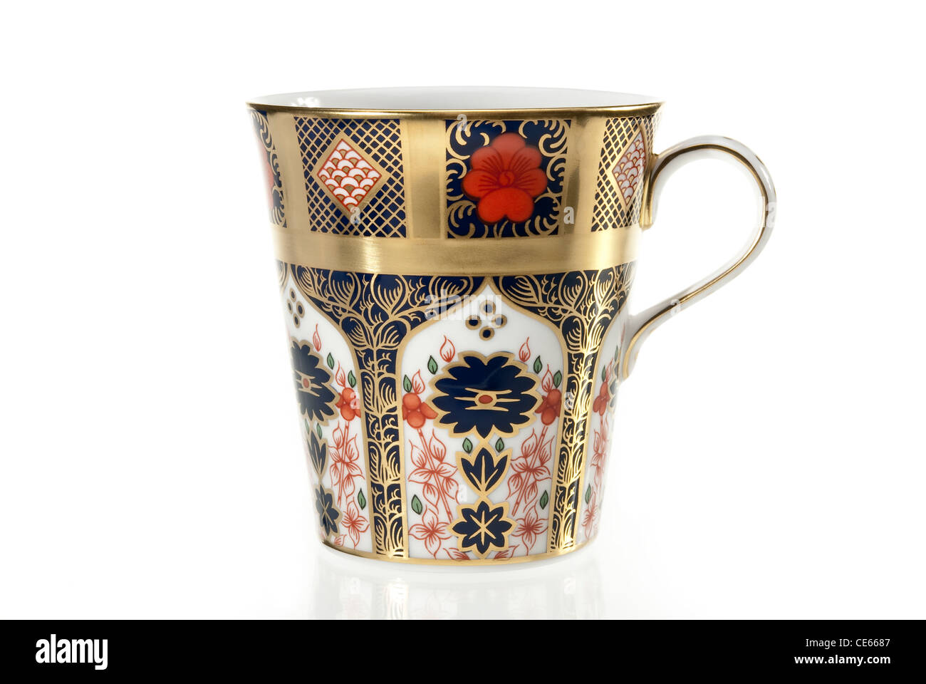 Fine bone china luxurious tea cup over white background - Stock Image