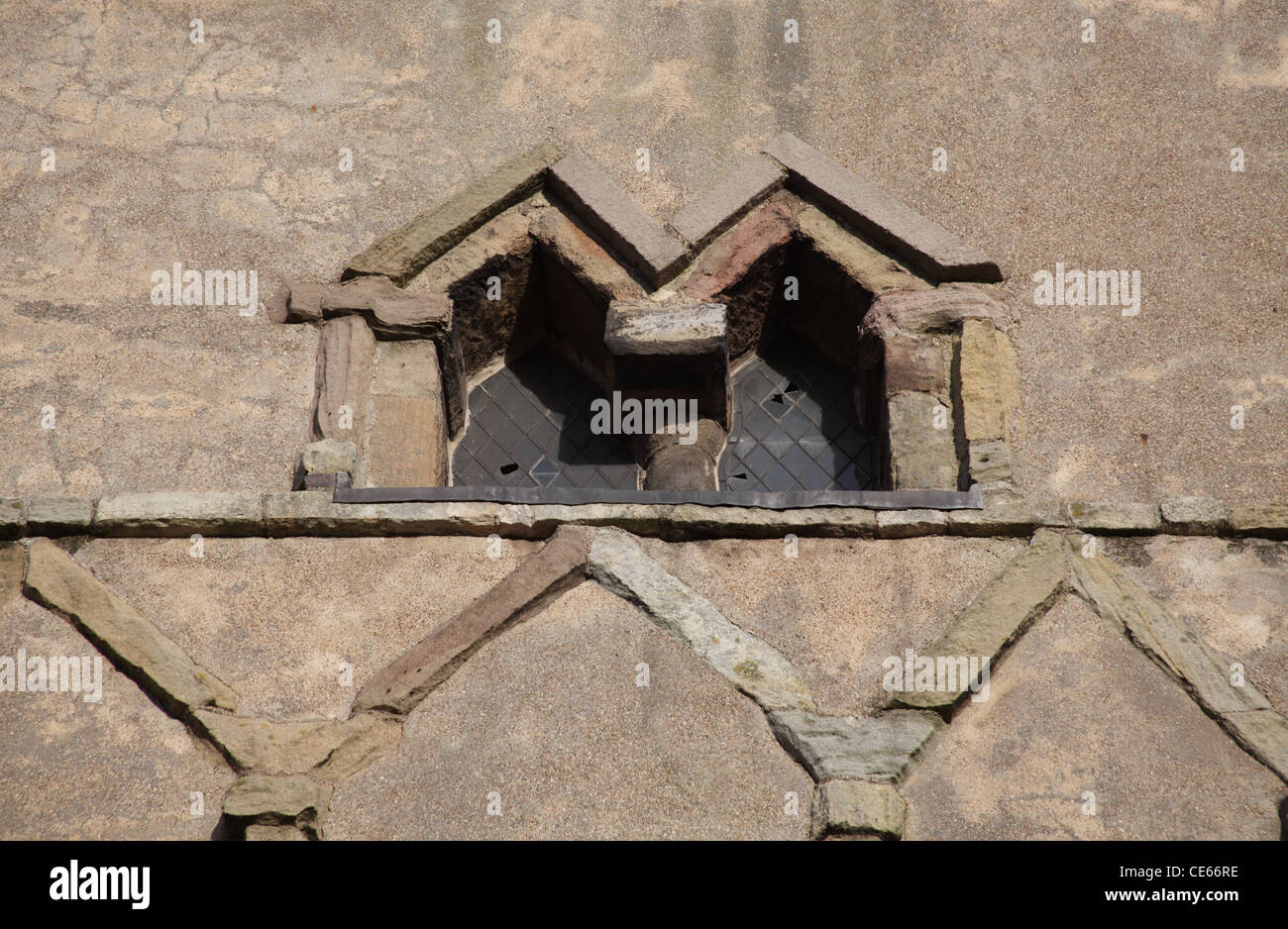 10th Century Anglo-Saxon Triangular Headed Windows in the bell tower of St Peter's Church, Barton Upon Humber, - Stock Image