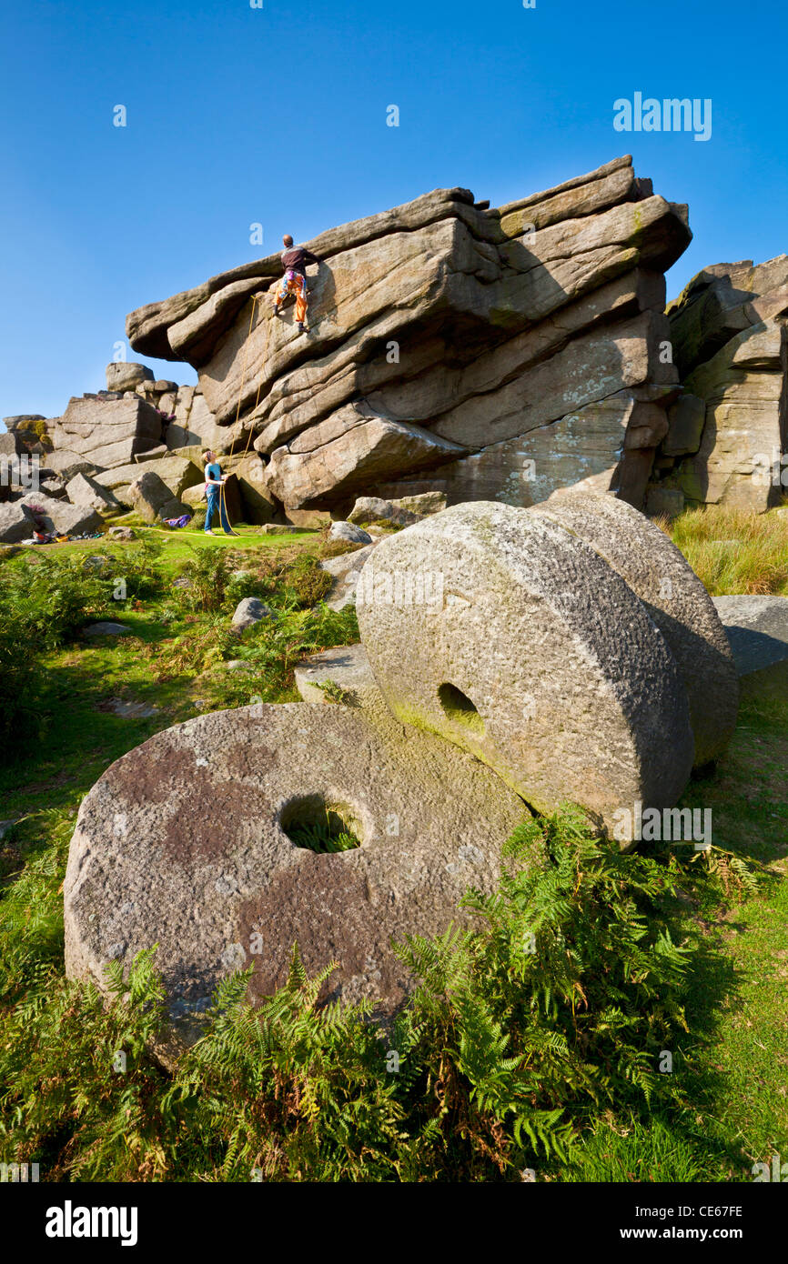 Two climbers practising above the old abandoned Millstones Stanage Edge Peak District Derbyshire England UK gb eu - Stock Image