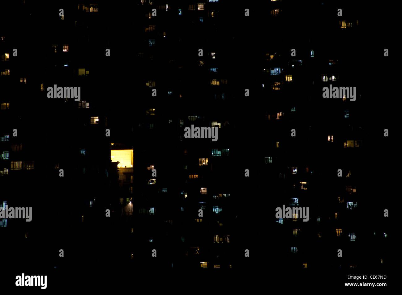 Lights of tower blocks and city lights at night reflected in the Shing Mun River ShaTin Hong Kong SAR China - Stock Image