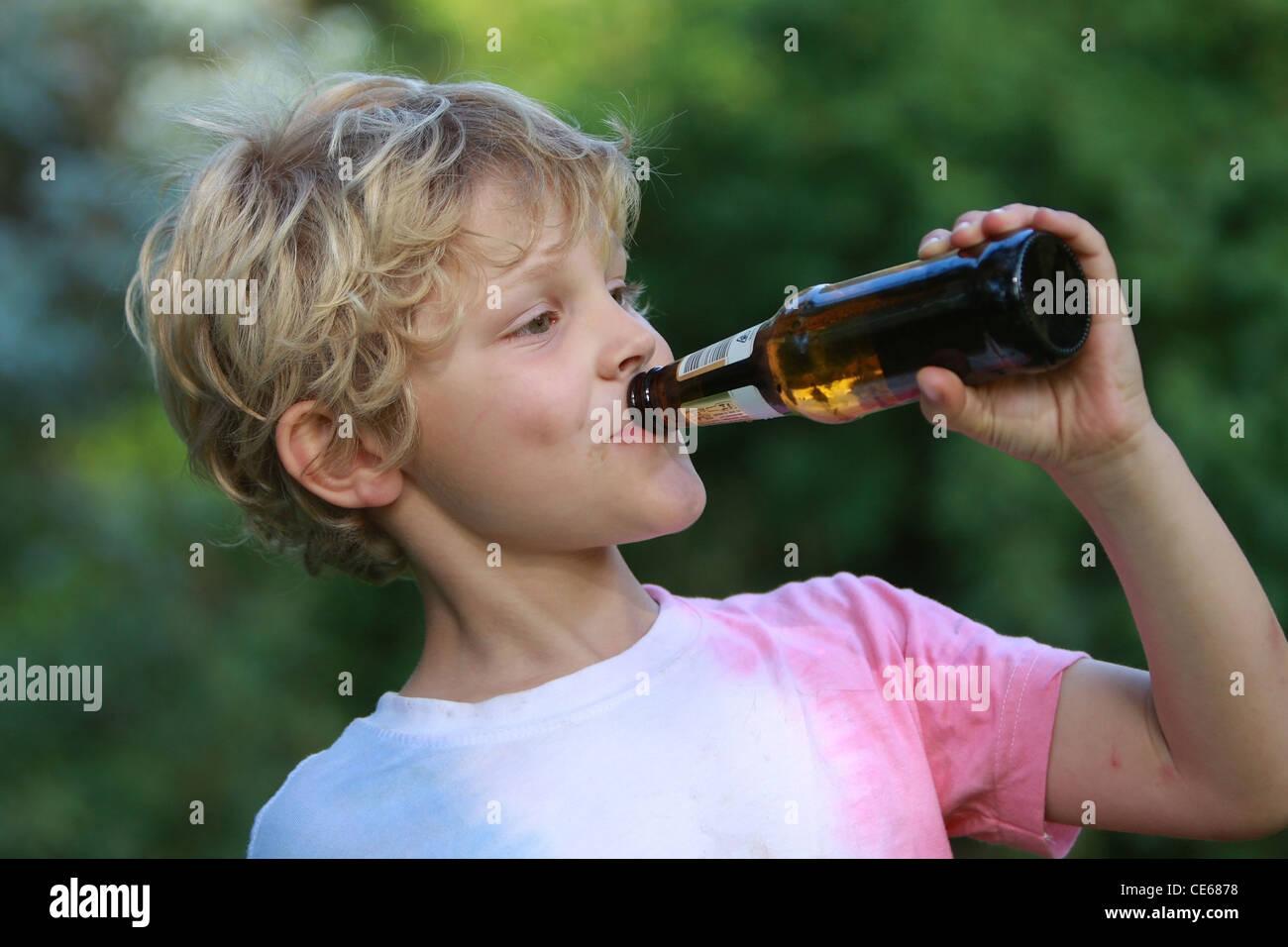 boy drinking beer - Stock Image