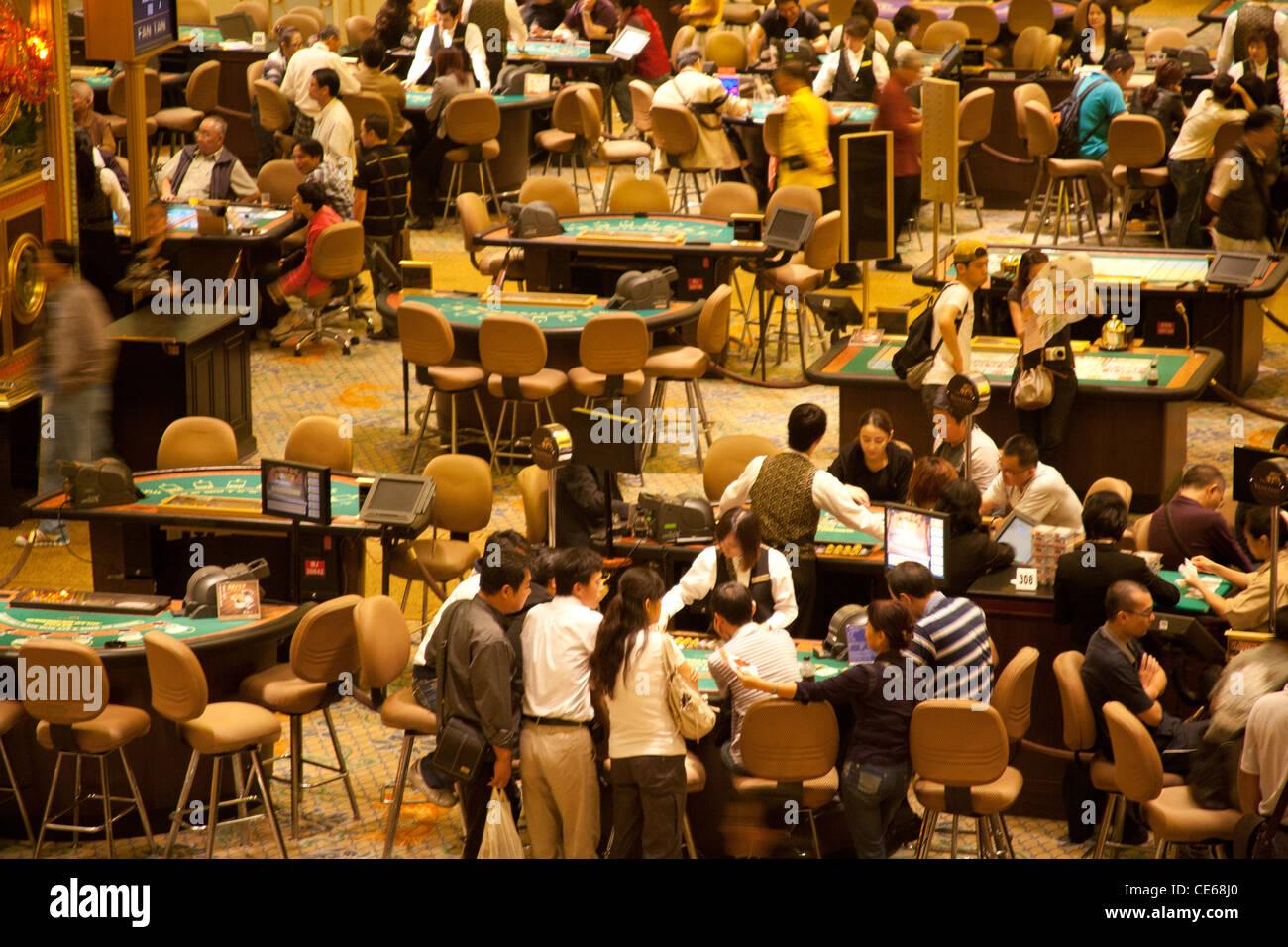 People gambling in the Venetian Casino, Venetian Casino and Hotel Cotai Complex, Strip Macau SAR China - Stock Image