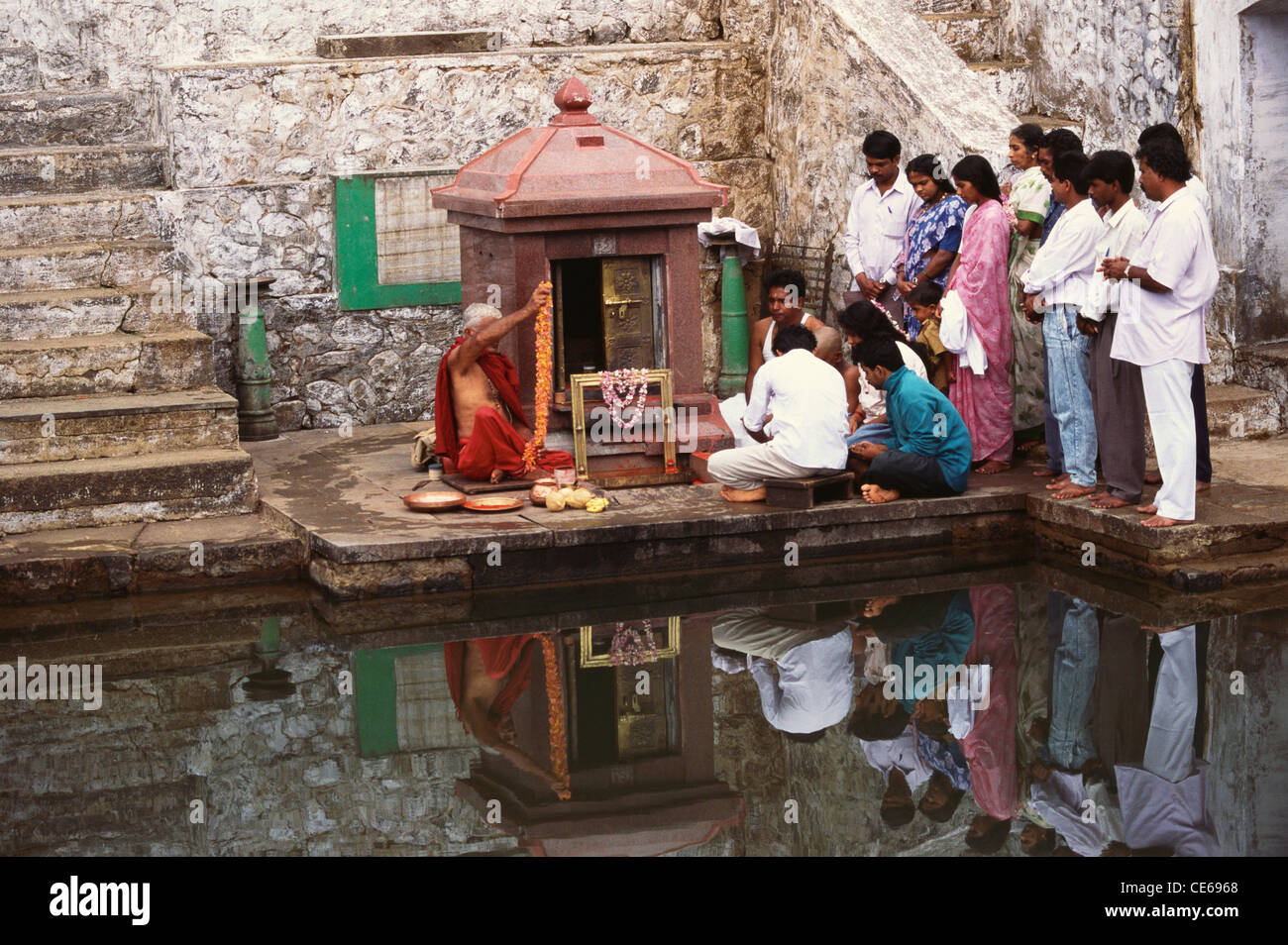 Doing pooja at Brahma Kundica Moola Cauvery in Talacauvery Kodagu Coorg ; Karnataka ; India - Stock Image