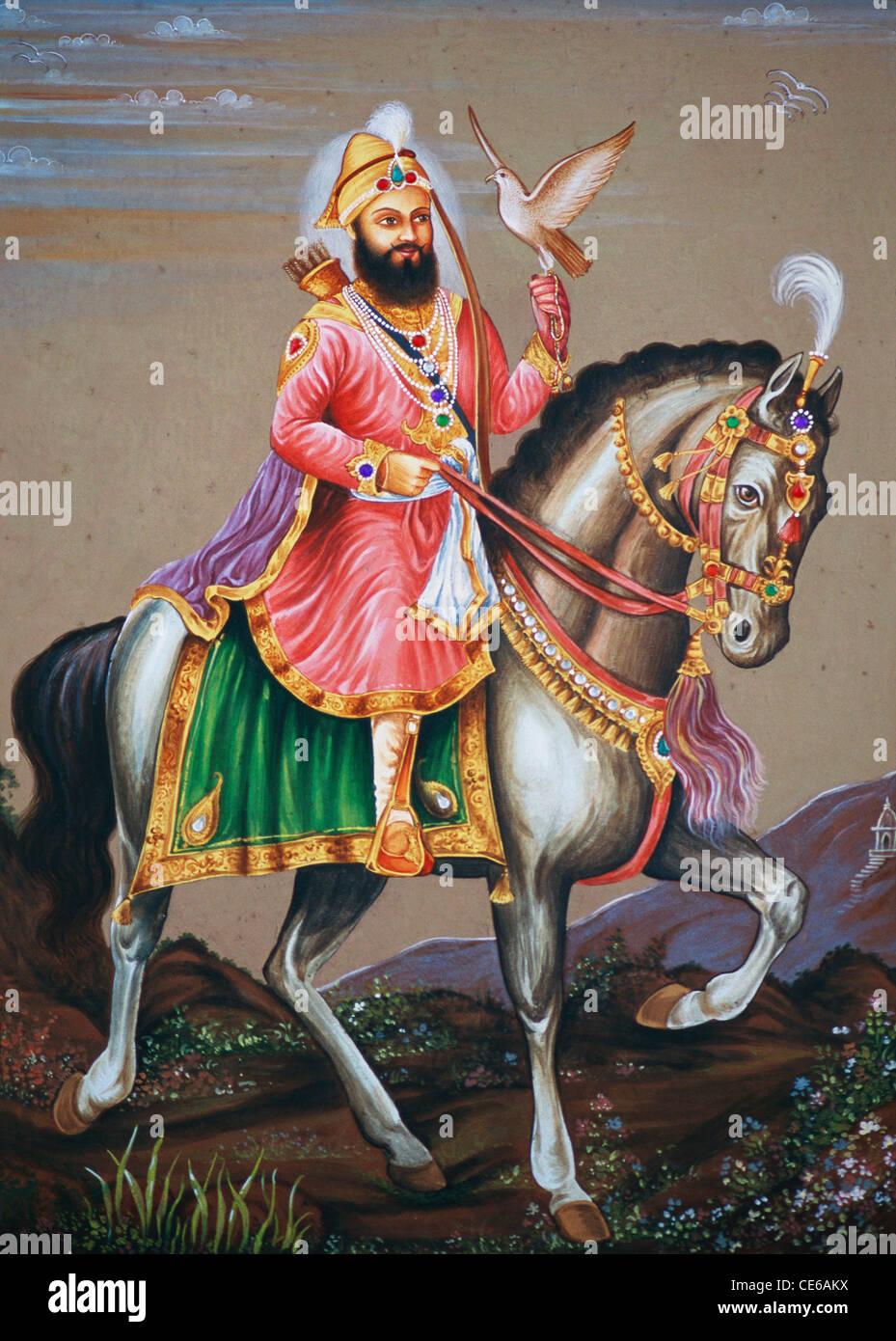 Guru Govind Singh riding on horse miniature painting on paper Stock Photo