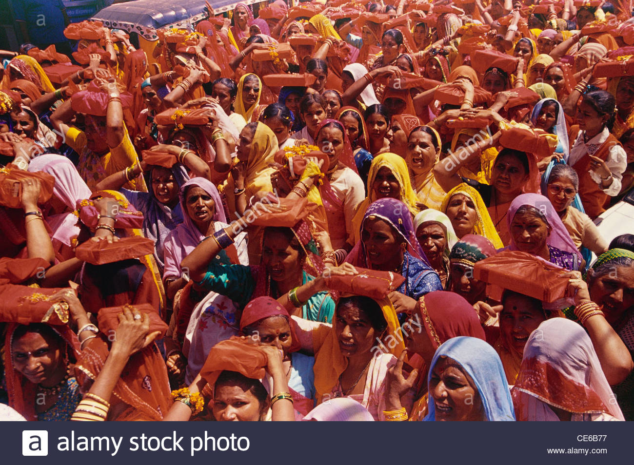 women carrying bhagwat geeta Bhagavad gita on head in a religious procession ; Jodhpur ; Rajasthan ; India - Stock Image