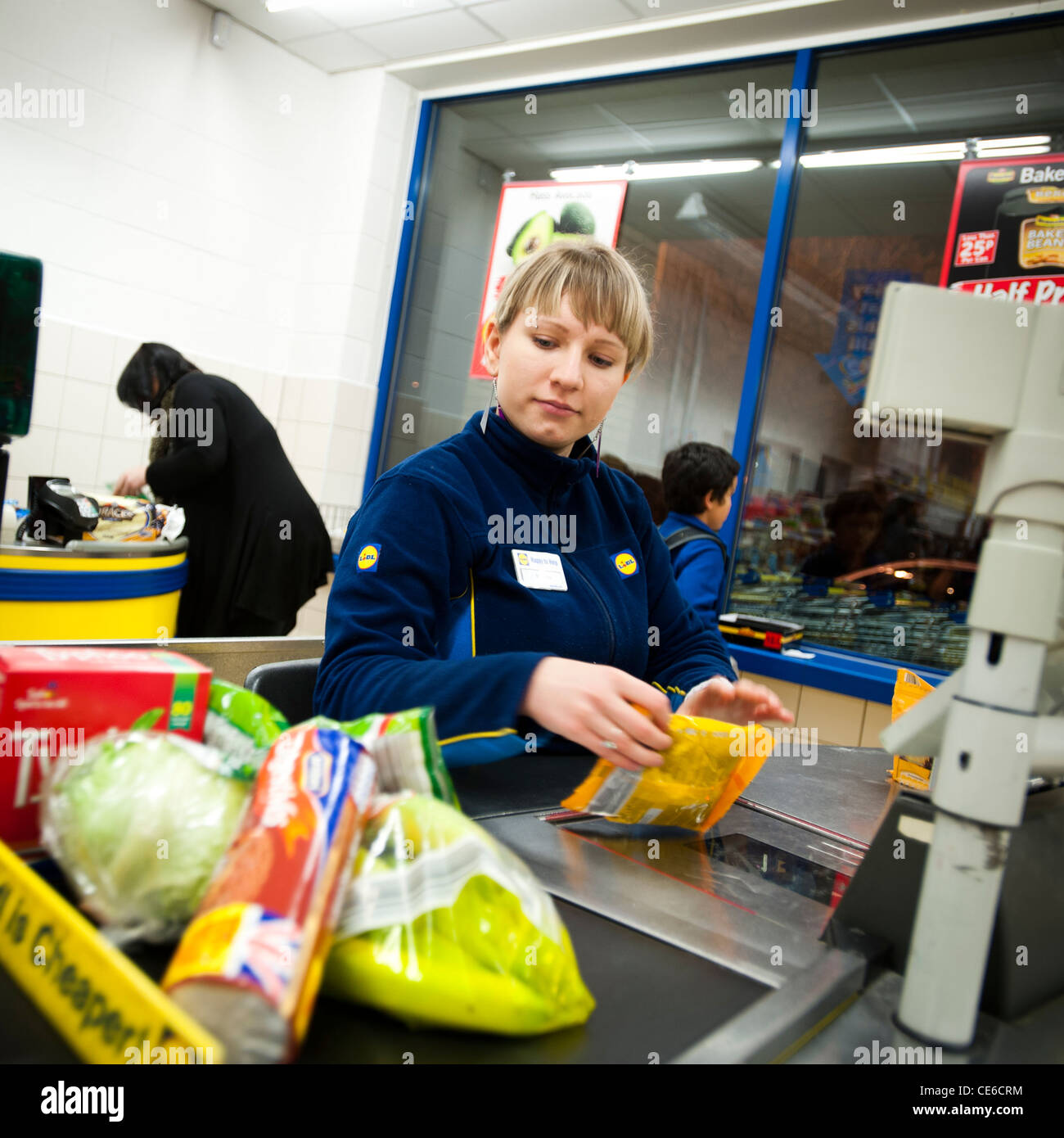 A woman check out worker at a branch of lidl discount supermarket stock photo 43167704 alamy - Mobel discount kassel ...