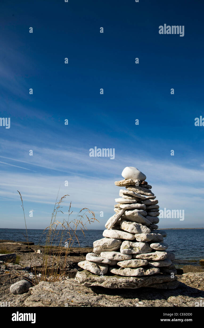 stone tower at the beach of Kattelviken on the island of Gotland in Sweden, Baltic Sea - Stock Image