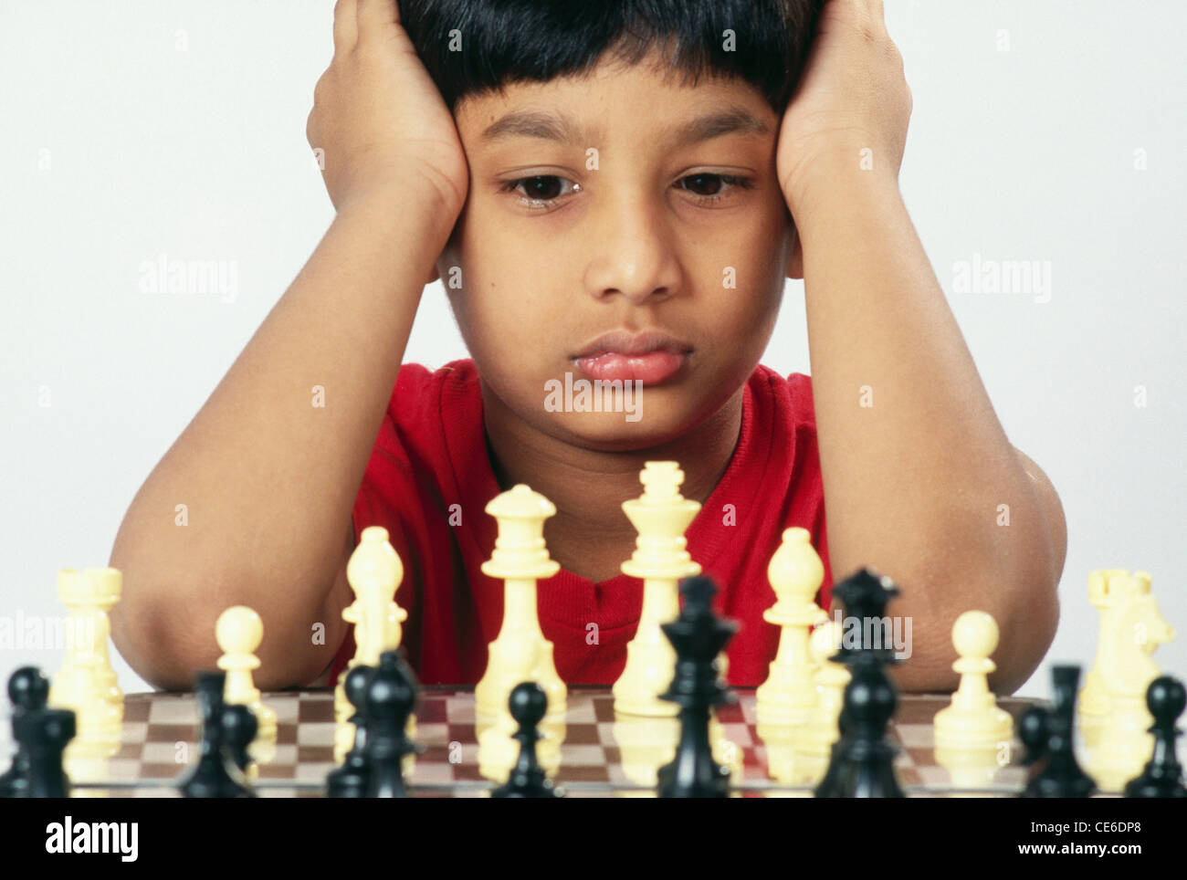 small young boy playing chess   MR#152 Stock Photo