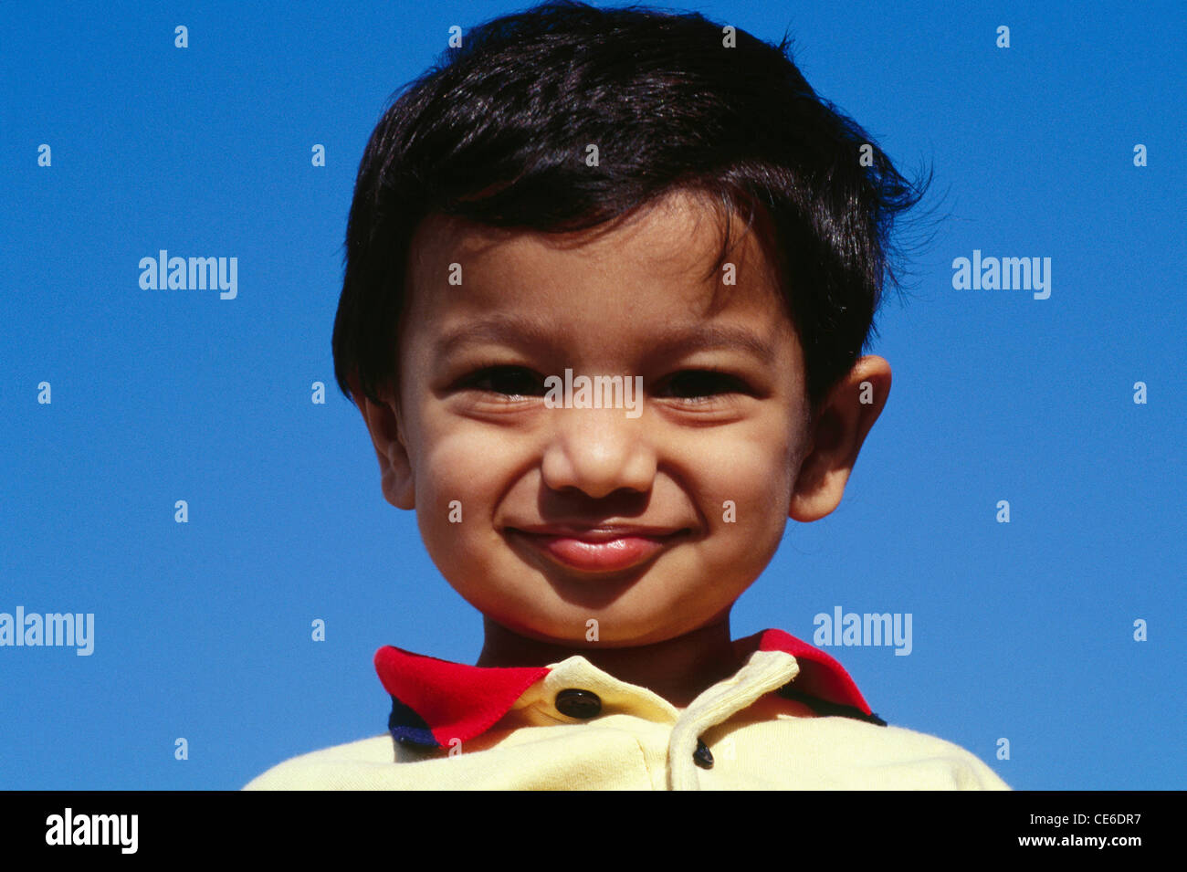 smart young small indian boy against blue sky india MR#152 Stock Photo