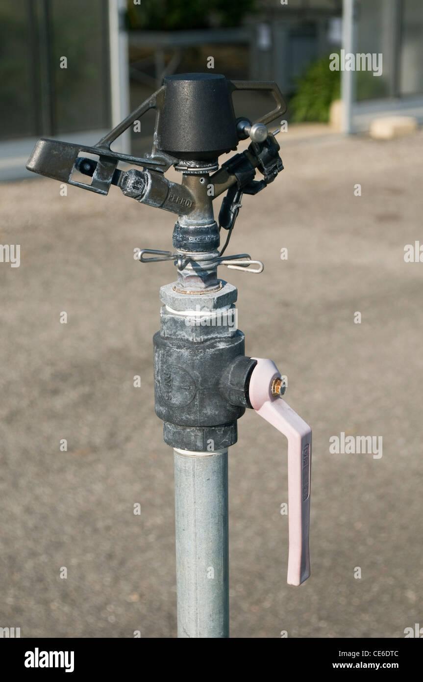 greenhouse water sprinkler tap - Stock Image