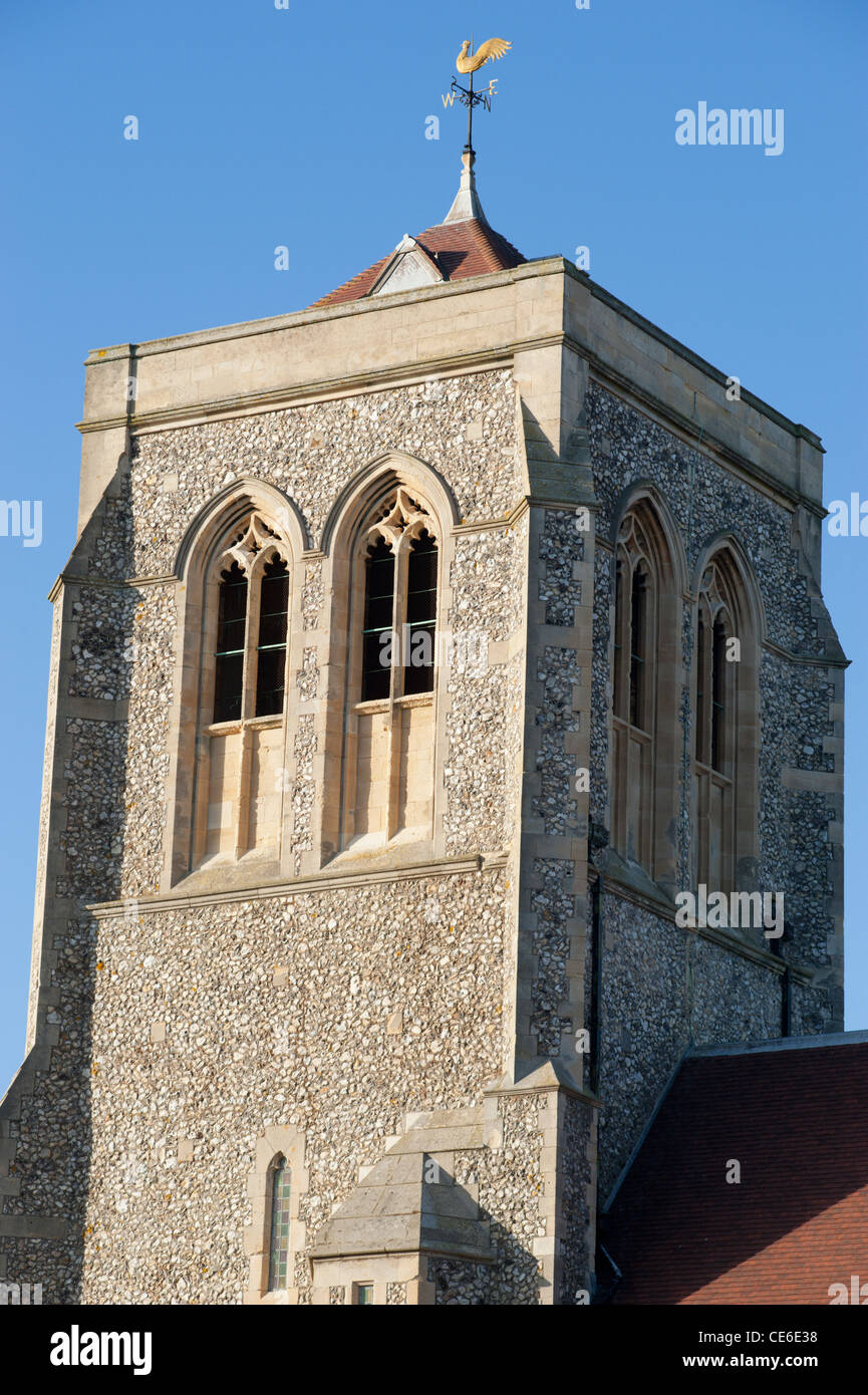 The tower of Saint Michael and All Angels church in Eastbourne, East Sussex, England, UK against a blue sky. - Stock Image