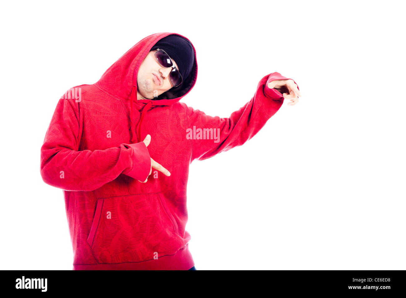 Hip Hop dancer in red hoodie pointing, isolated on white background. - Stock Image