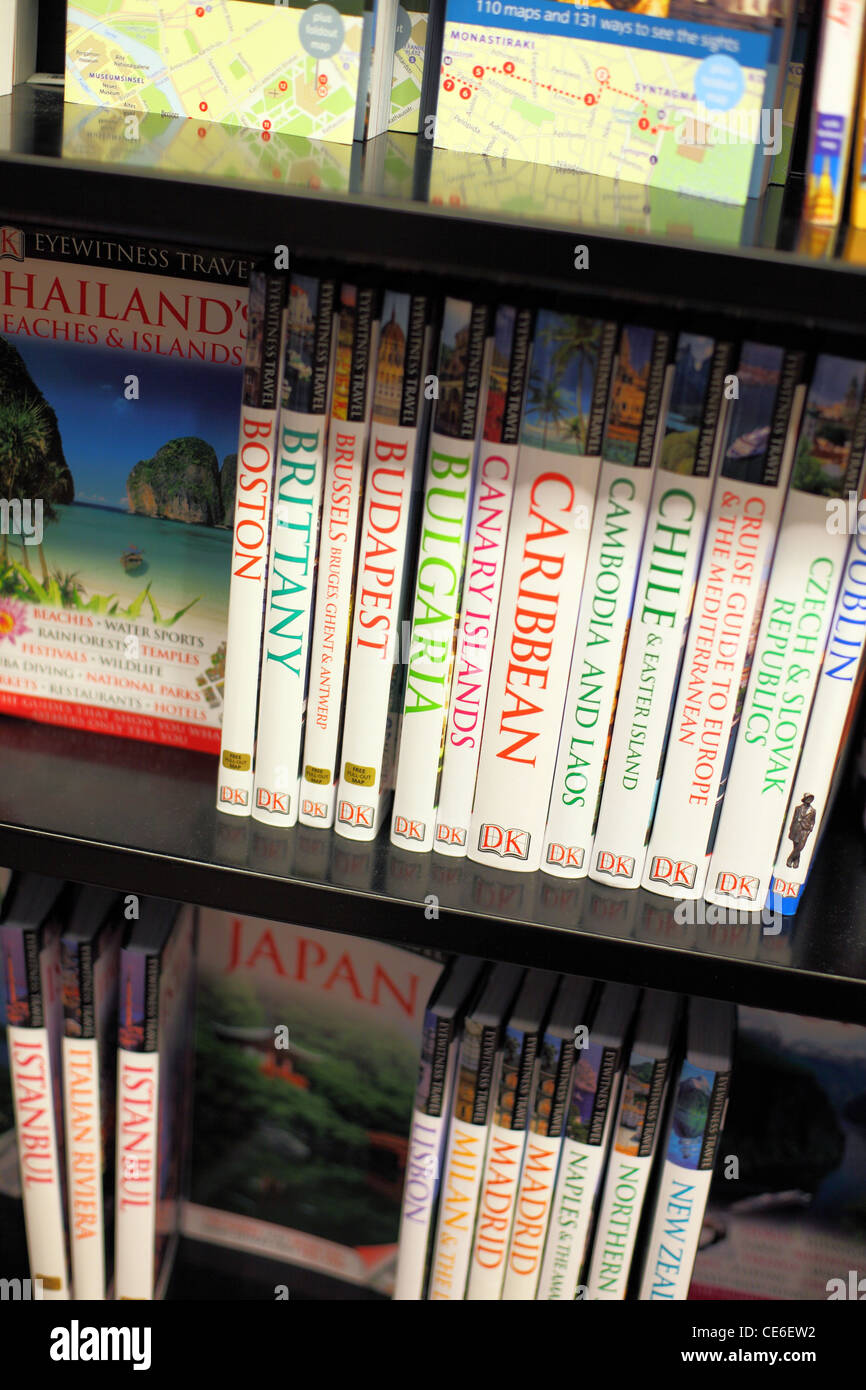 Travel guide books for sale in book store. - Stock Image