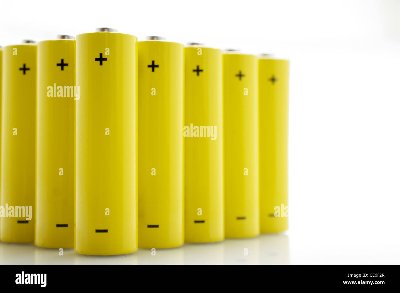 set of AA batteries lined up on a white background - Stock Image