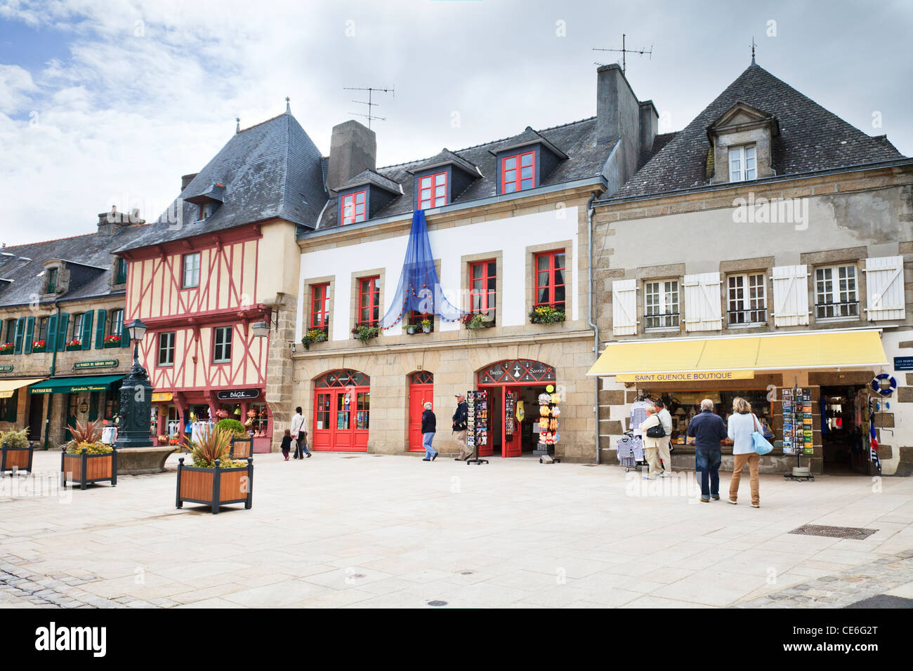 People strolling in the Town Square of Concarneau, Brittany, France. - Stock Image