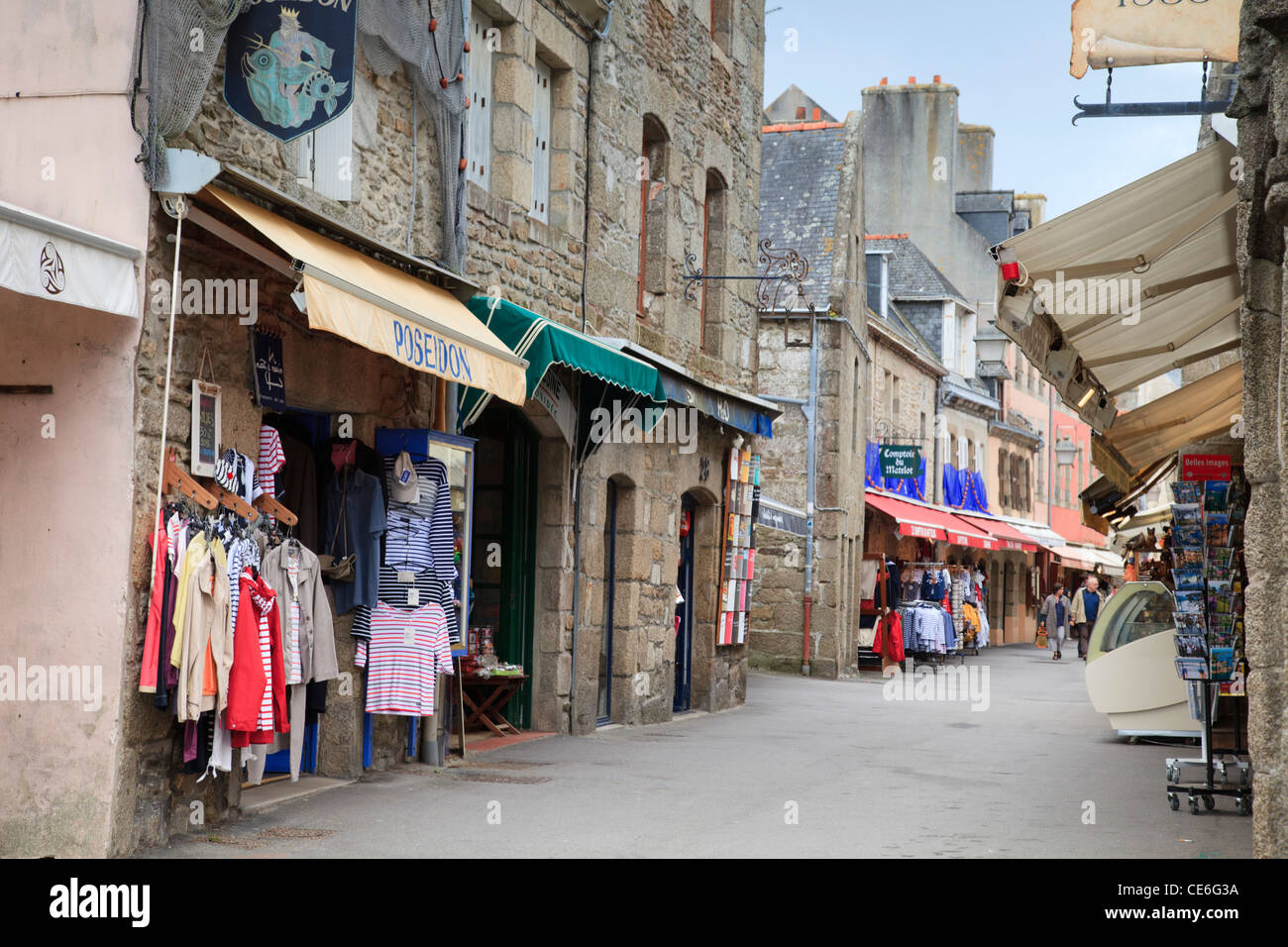 Souvenir shops selling striped Breton clothing in the Ville Close at Concarneau, Brittany, France. - Stock Image