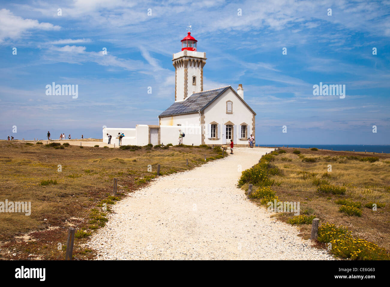 Visitors at les Poulains lighthouse, at the northern tip of Belle Ile, Brittany. - Stock Image