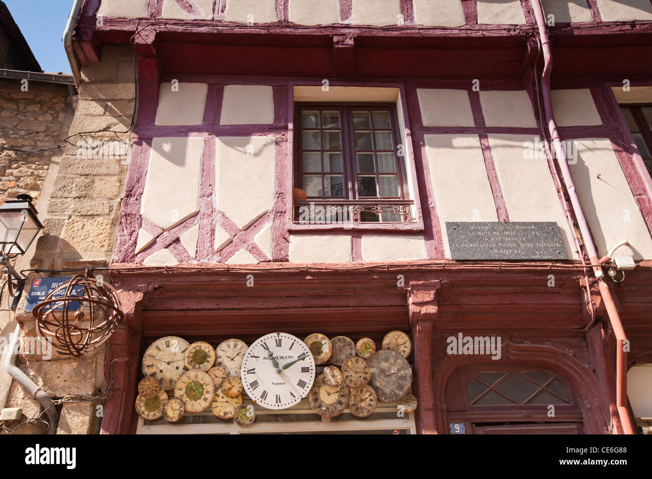 The half timbered building is home to a clockmaker in Vannes, Brittany, France. - Stock Image
