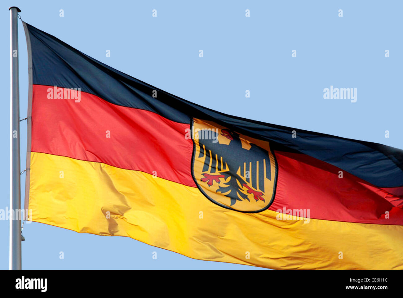 German flag with the Federal eagle at the mast in front of the Federal Chancellery in Berlin. Stock Photo