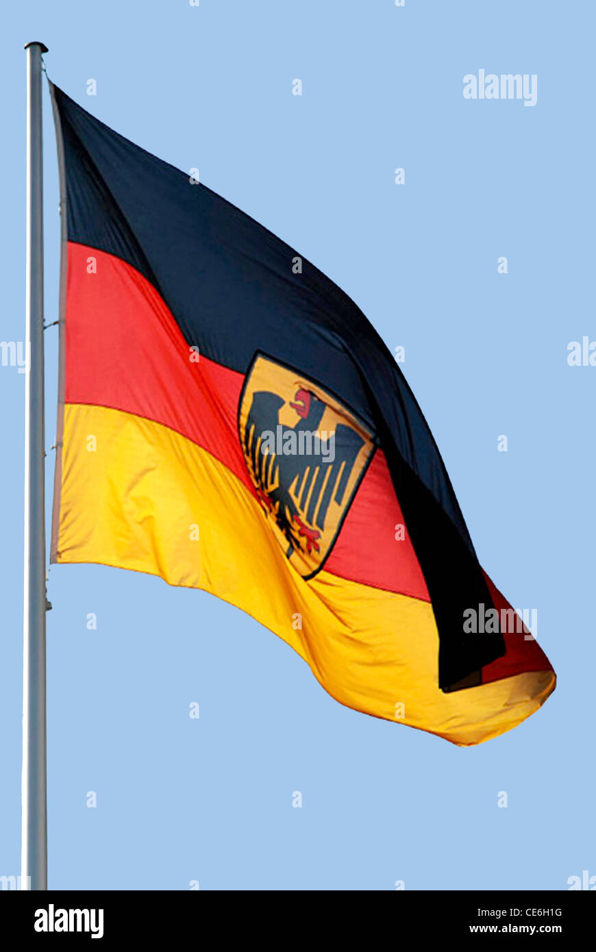 German flag with the Federal eagle at the mast in front of the Federal Chancellery in Berlin. - Stock Image
