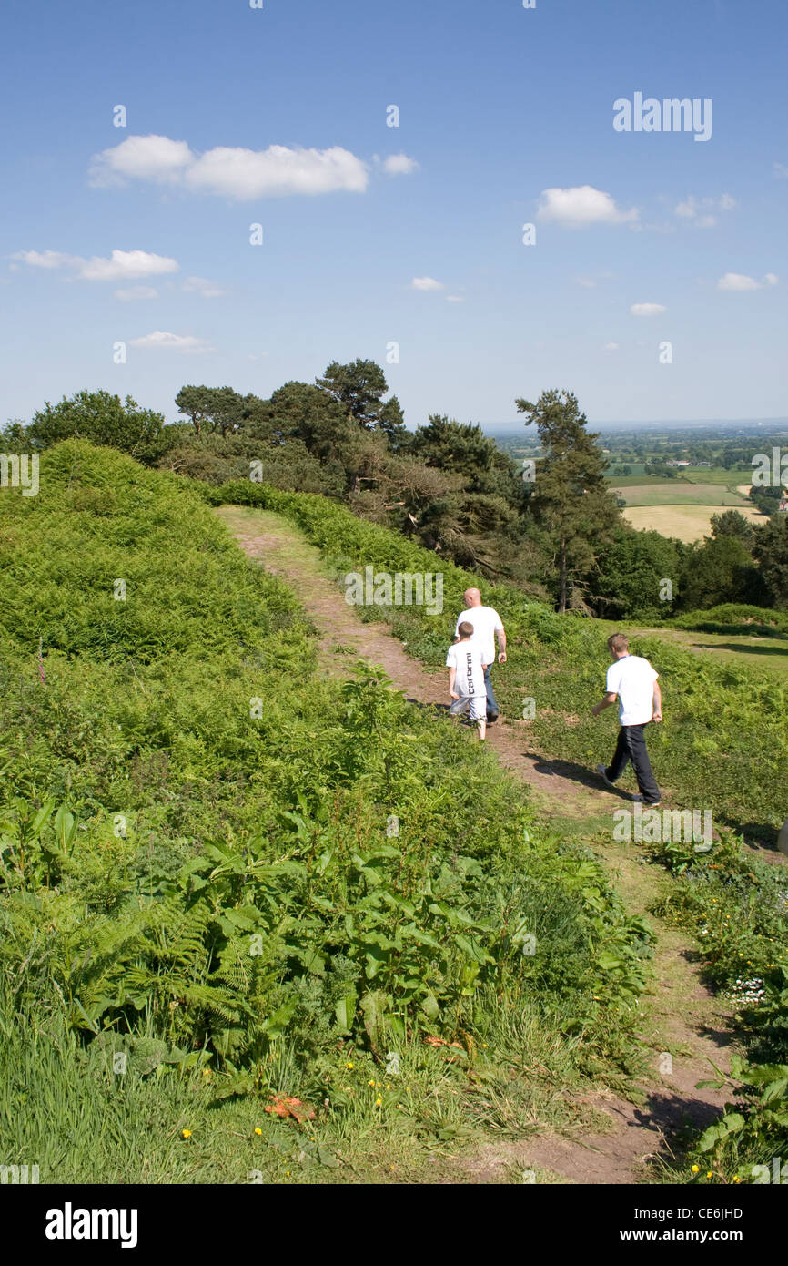 A man and two boys walking on a path in the Cheshire Countryside near Beeston Castle England. - Stock Image