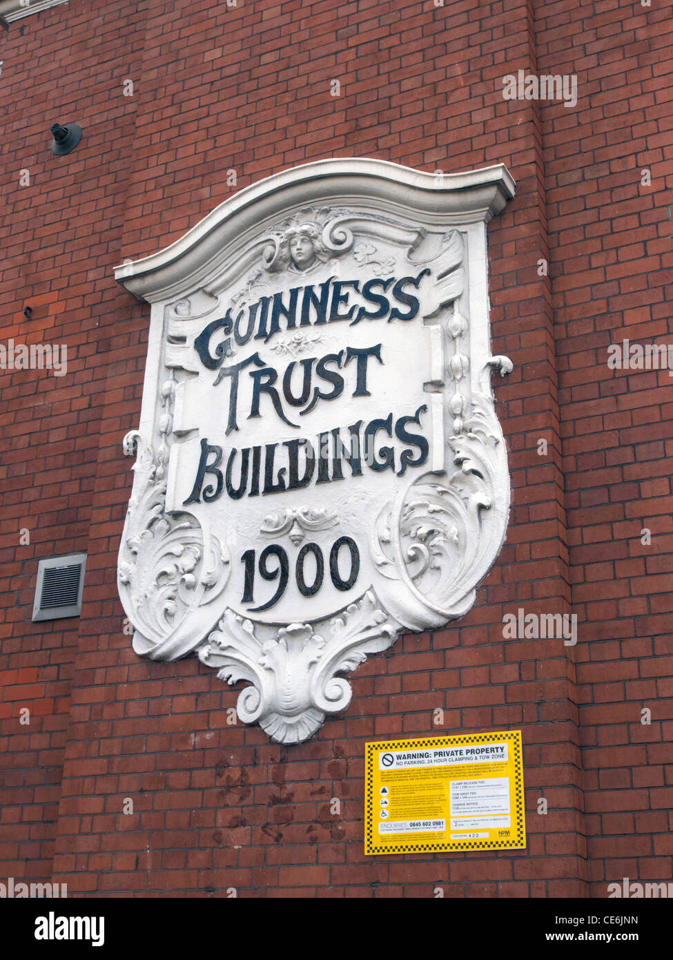 united kingdom west london fulham palace road guinness trust building sign - Stock Image
