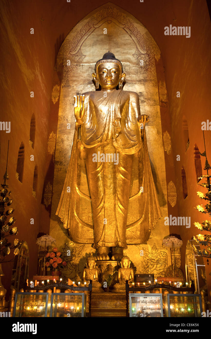 Gilt Buddha at Ananda Temple one of the best preserved of the Bagan temples. Stock Photo