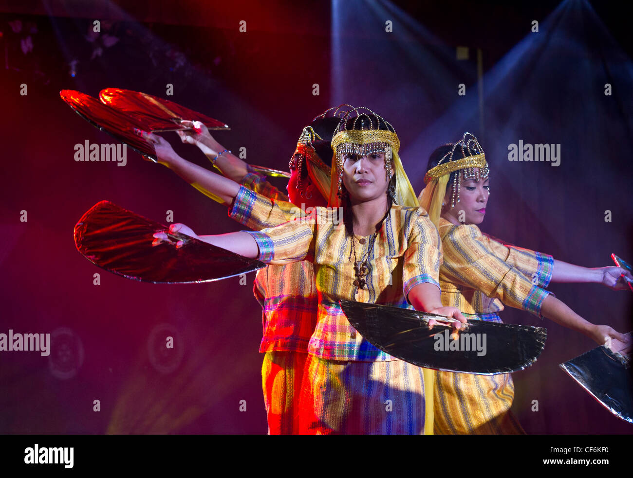 Crew members of cruise ship Boudicca putting on a show to entertain passengers: the Filipino fan dance - Stock Image
