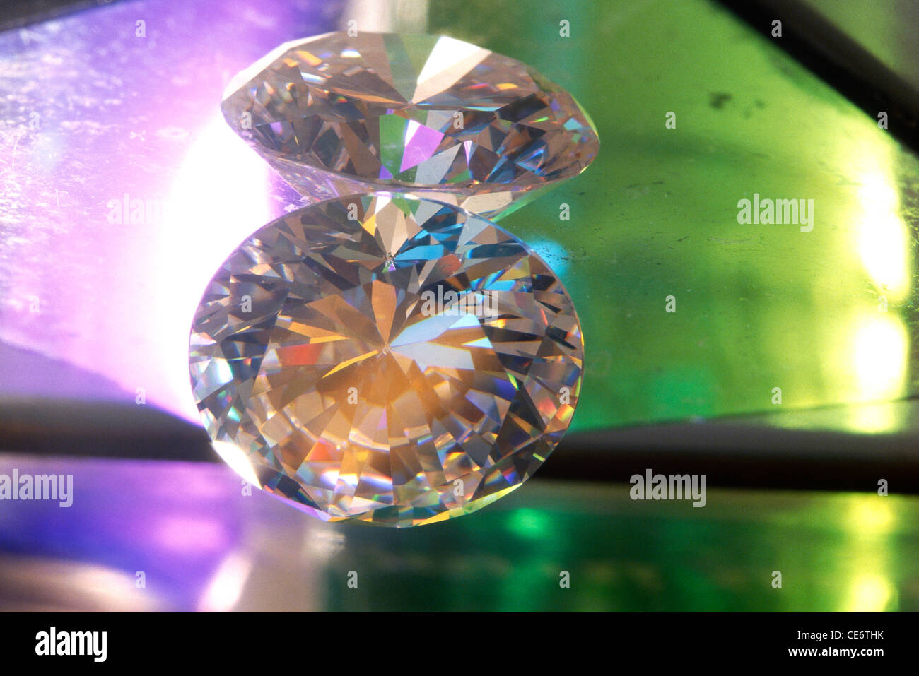 AAD 85190 : cut polished shining diamonds showing facets colours - Stock Image