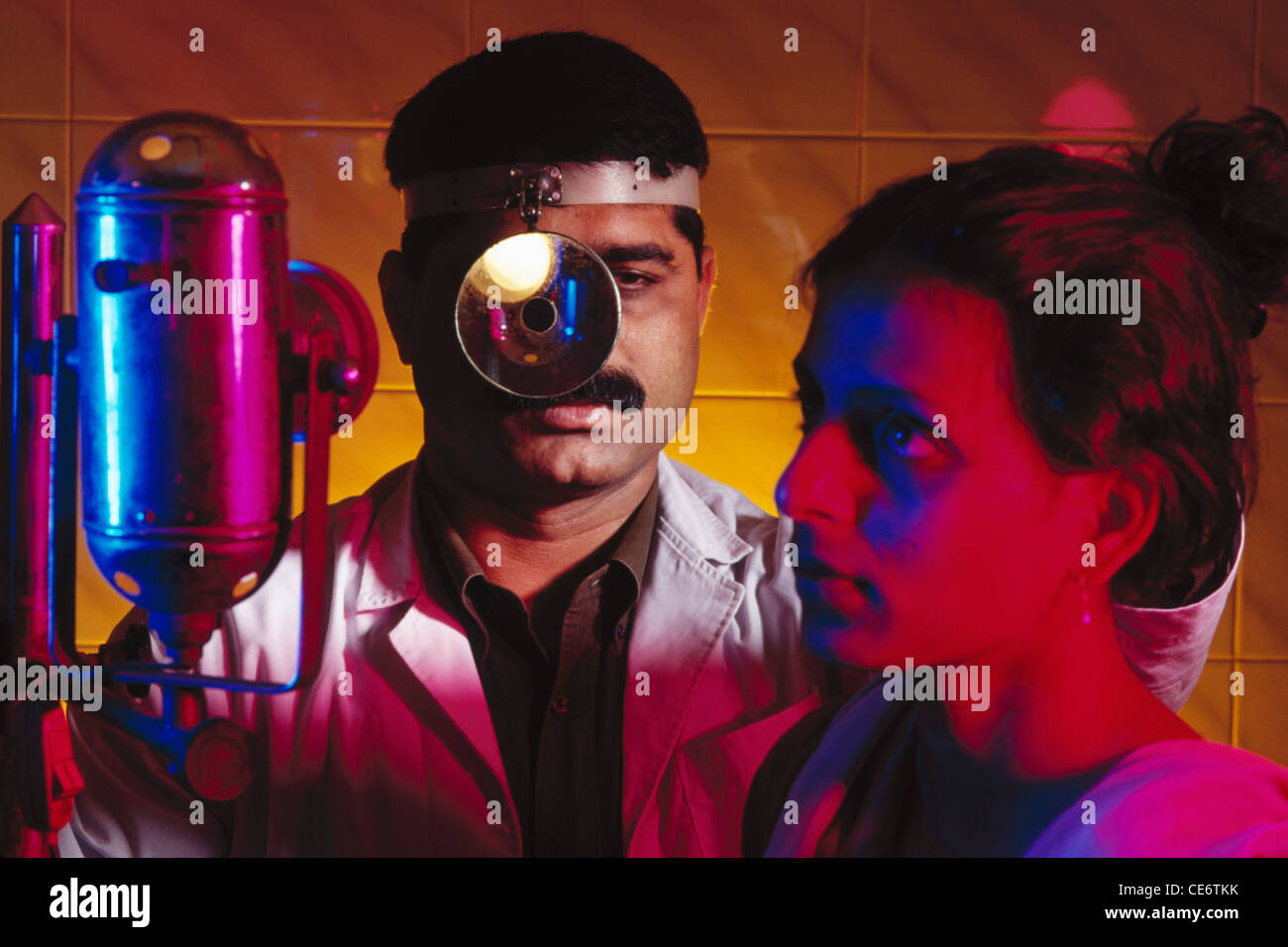 HMA 85149 : ENT ear nose throat specialist doctor checking patient - Stock Image