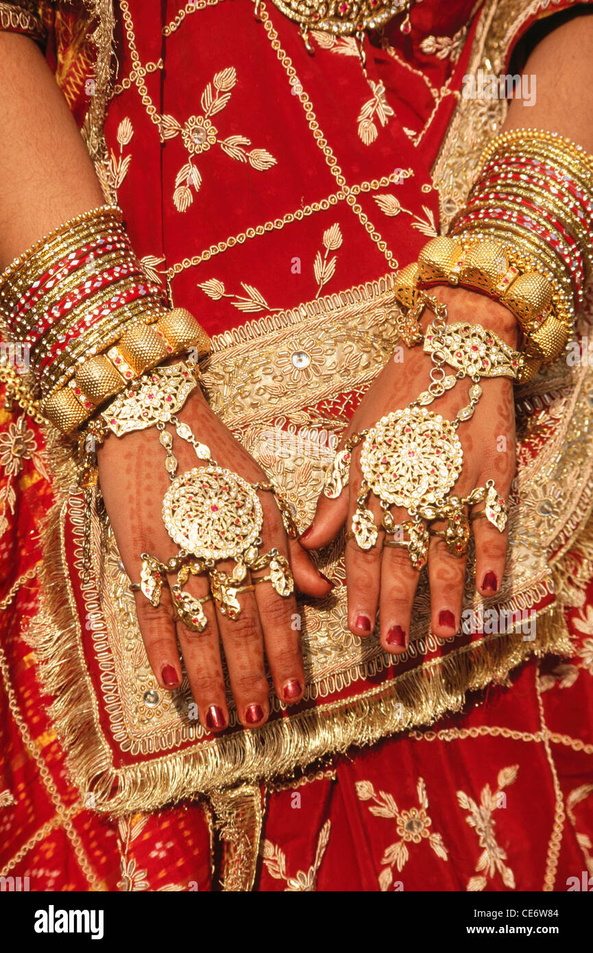 Closeup Of Hands With Mehndi And Gold Hand Jewelry Gold Bangles Red