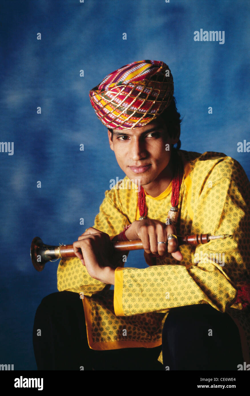 BDR 83387 : portrait of indian rajasthani folk musician posing with wind musical instrument shehnai rajasthan india Stock Photo