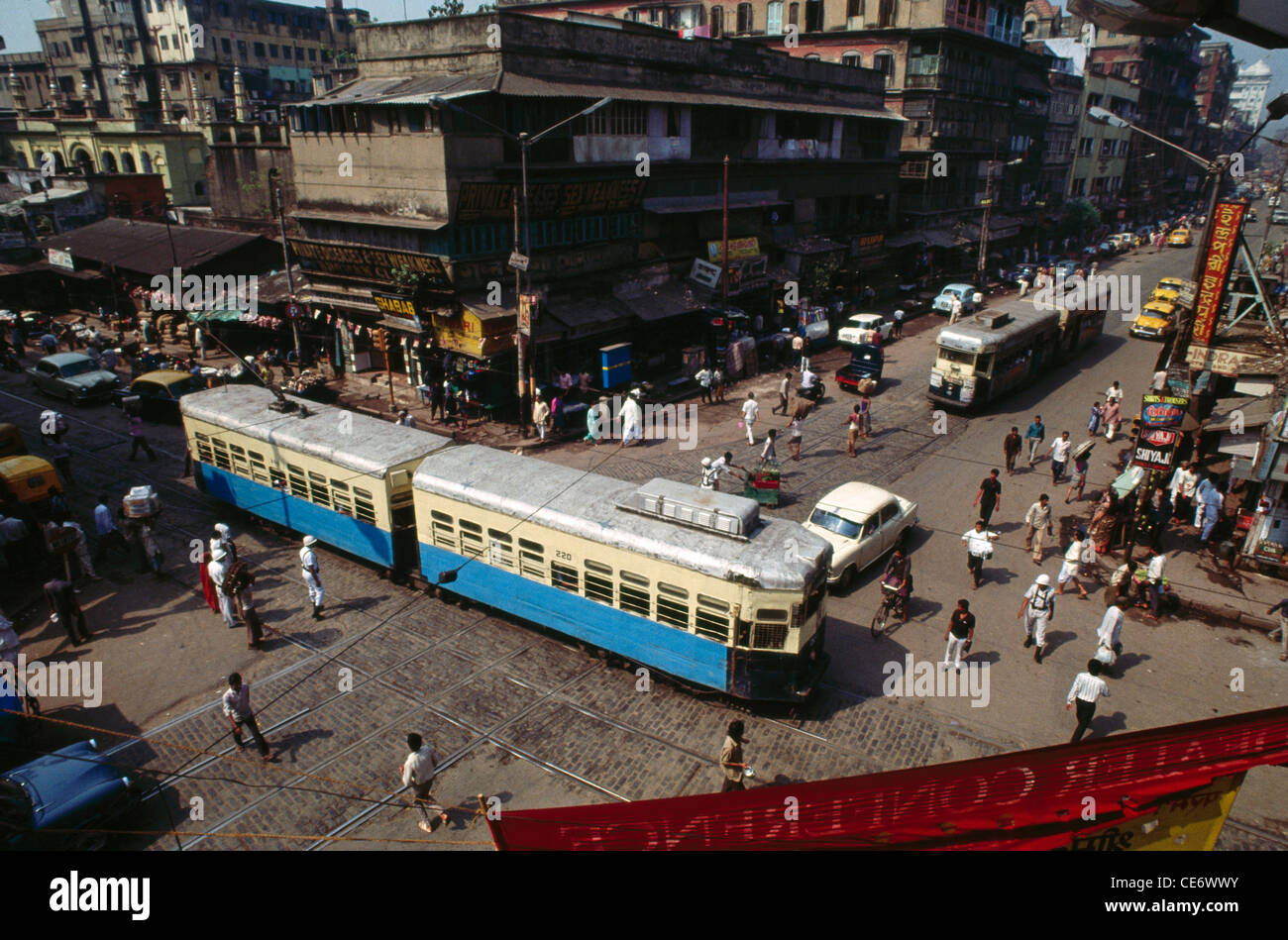 RAA 85370 : aerial view electric trams running on streets of calcutta kolkata west bengal india - Stock Image