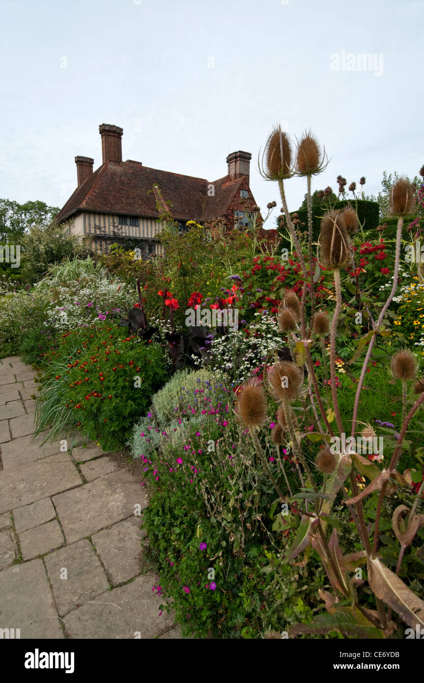 A long border of flowers and shrubs in the gardens of Great Dixter ...