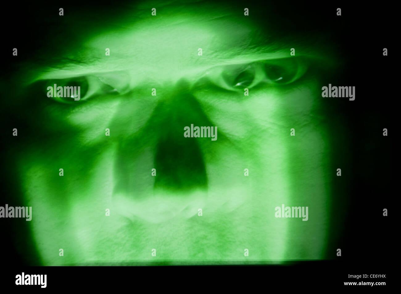 green evil menacing face - Stock Image