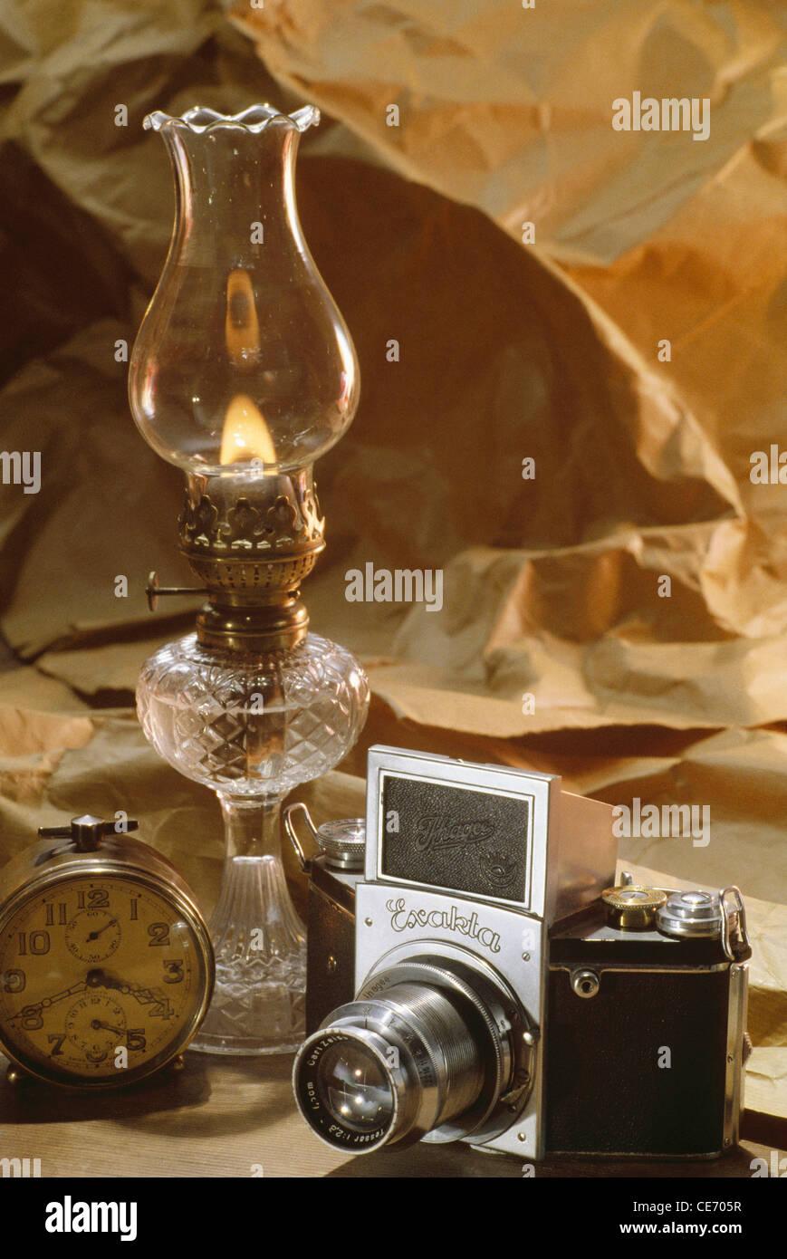 AAD 83956 : old exacta camera alarm clock kerosene lamp - Stock Image