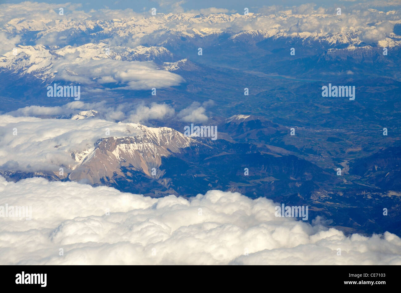 Snow on French Alps summits at spring, France, (aerial view) - Stock Image