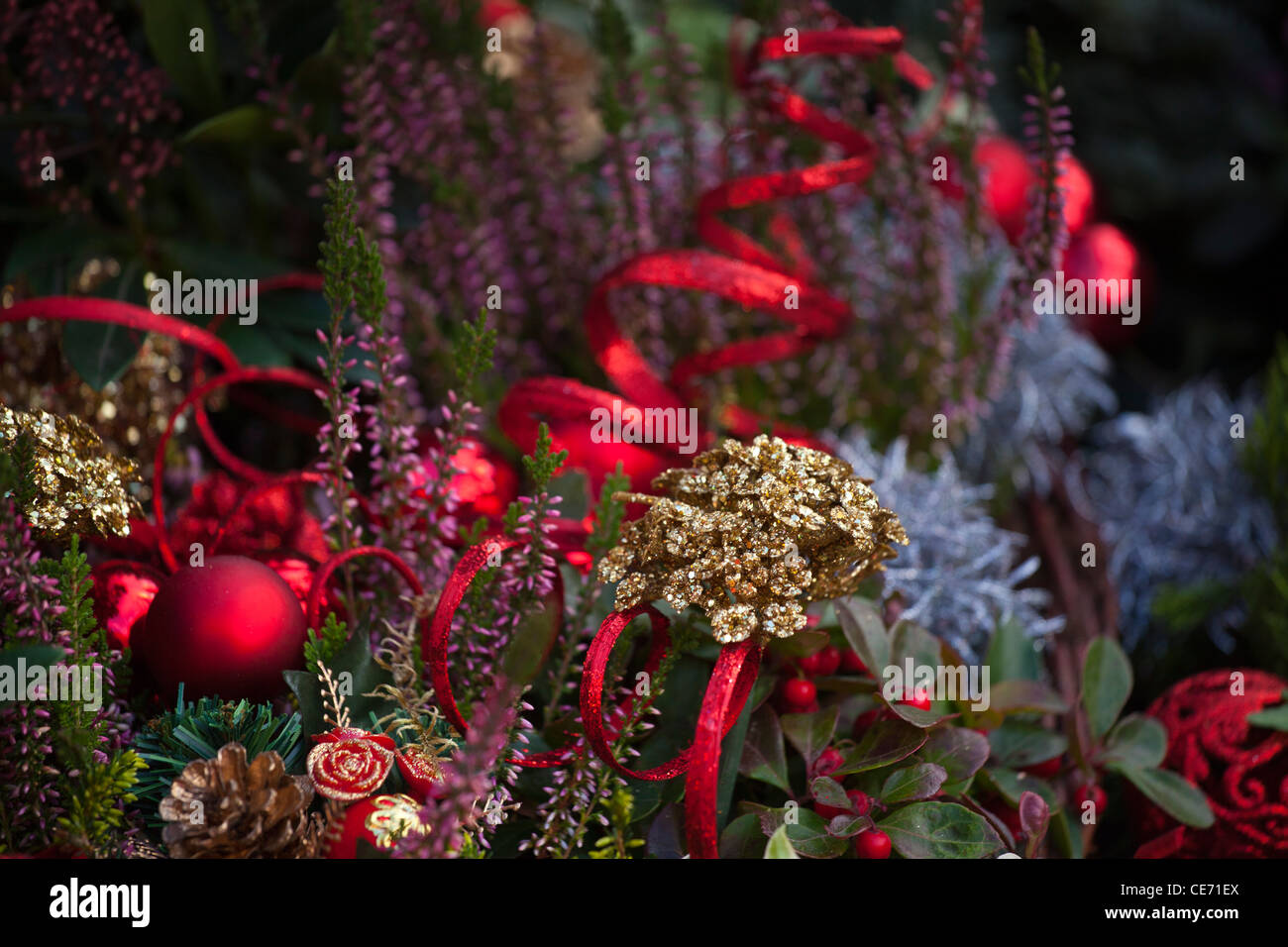 England, Greater Manchester, Manchester. Christmas decorations on sale at a stall on the Town Hall Christmas Market. - Stock Image