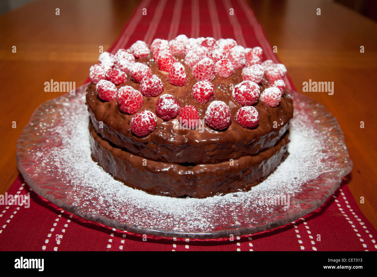 Whole Delicious Birthday Cake With Chocolate Ganache And Raspberries Dusting Of Powdered Sugar