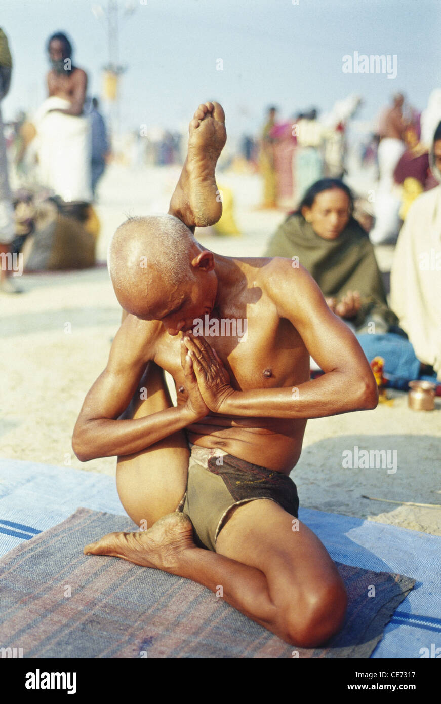 SOA 81803 Indian Man Difficult Twisted Complicated Yoga Pose Kumbh Fair Allahabad Uttar Pradesh India