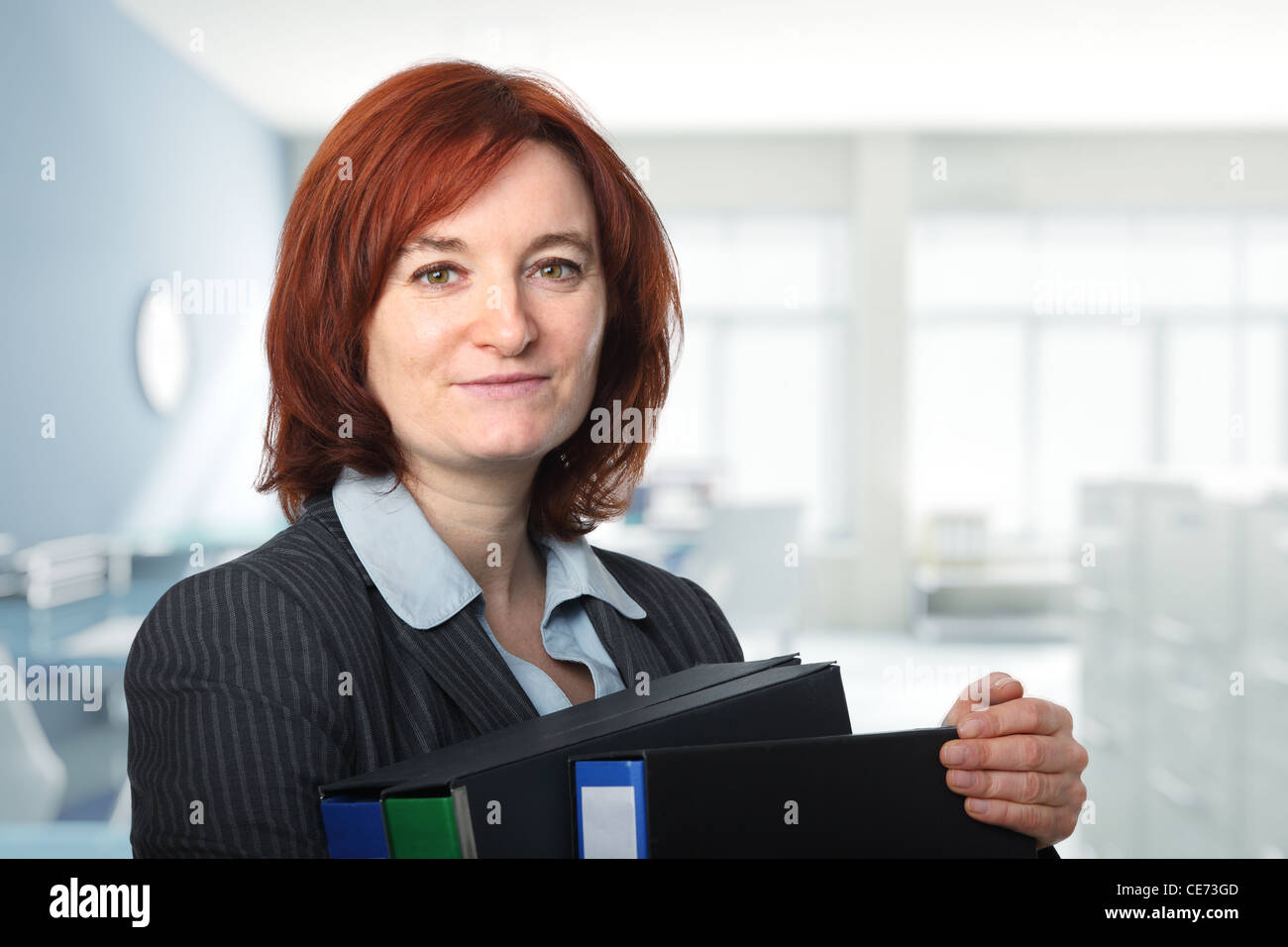 portrait of woman with file folder - Stock Image
