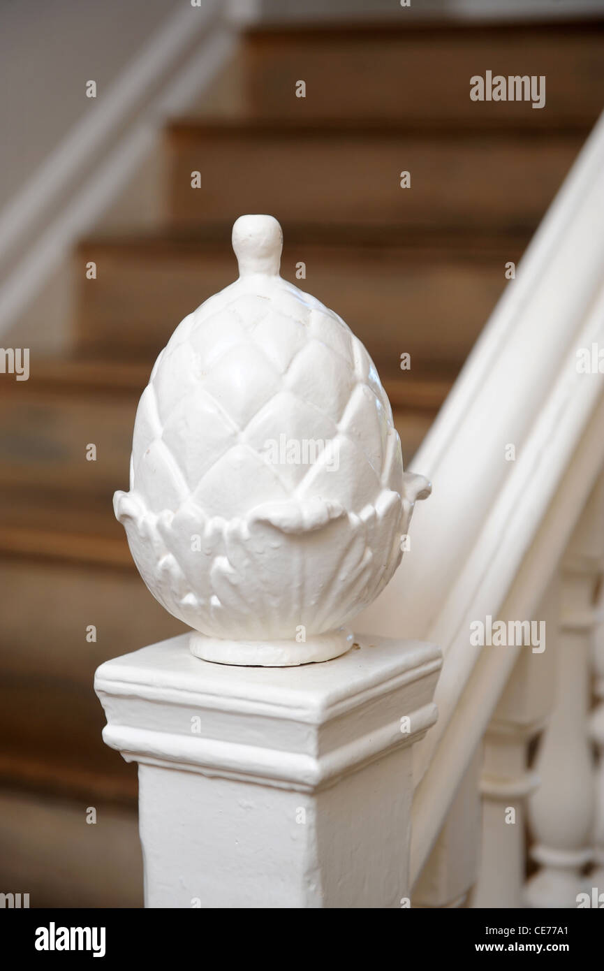 A Pineapple Finial At The Base Of A Staircase Bannister Uk Stock